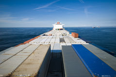 Container Cargo Ship and horizon Stock Images