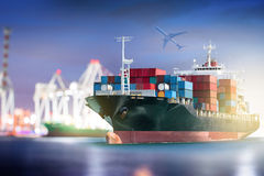 Container Cargo ship with ports crane bridge in harbor and Cargo plane for logistic. Import export background and transport industry Royalty Free Stock Photo