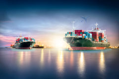 Container Cargo ship with ports crane bridge in harbor and Cargo plane for logistic import export background. And transport industry Stock Images