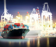 Container Cargo ship with ports crane bridge in harbor Stock Photography