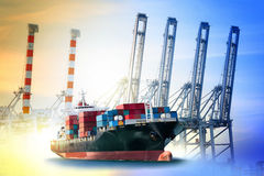 Container Cargo ship with ports crane bridge in harbor Royalty Free Stock Photo