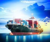 Container Cargo ship with ports crane bridge in harbor Stock Photos