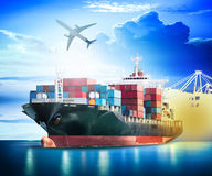 Container Cargo ship with ports crane bridge in harbor. And Cargo plane for logistic import export background and transport industry Stock Image