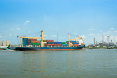 Container cargo ship sailing on the water. Royalty Free Stock Photo