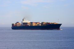 Container cargo ship at sea. Royalty Free Stock Images