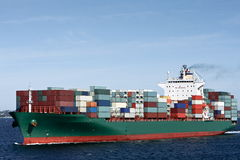 Container cargo ship at sea. Large green container cargo ship at sea Royalty Free Stock Photo