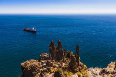 Container cargo ship and vessel on horizon Royalty Free Stock Image