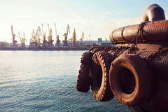 Container Cargo Ship with working crane bridge in shipyard background, Freight Transportation, Logistic Import Export background c. Oncept Royalty Free Stock Image