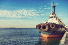 Container Cargo Ship with working crane bridge in shipyard background, Freight Transportation, Logistic Import Export background c. Oncept Royalty Free Stock Photography