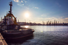 Container Cargo Ship with working crane bridge in shipyard background, Freight Transportation, Logistic Import Export background c. Oncept Stock Images