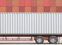 Container cargo truck and stack of container Royalty Free Stock Photo
