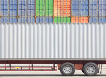 Container cargo truck and stack of container Stock Photo