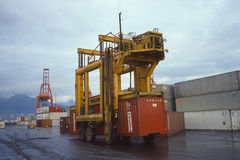 Container carrier on shipping dock Royalty Free Stock Photography