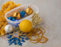 Container of  Christmas baubles and Christmas tree decorations Stock Photos