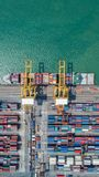Container,container ship in import export and business logistic,. By crane,Trade Port , Shipping,cargo to harbor.Aerial view,Water transport,International,Shell Stock Photo