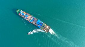 Container,container ship in import export and business logistic,. By crane,Trade Port , Shipping,cargo to harbor.Aerial view,Water transport,International,Shell Stock Photography