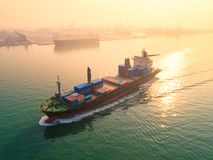 Container,container ship in import export and business logistic,. By crane,Trade Port , Shipping,cargo to harbor.Aerial view,Water transport,International,Shell Stock Photos