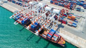 Container,container ship in import export and business logistic,By crane,Trade Port , Shipping,cargo to. Harbor.Aerial view,Water transport,International,Shell royalty free stock images