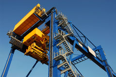 Container Crane. A huge container crane loading yellow containers Royalty Free Stock Image