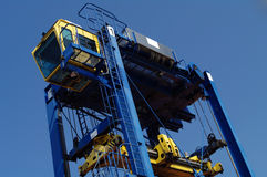 Container crane. Container transport vehicle for transporting across containers Stock Image