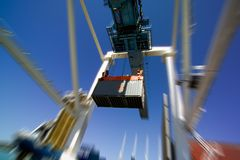 Container and crane. Container in motion loaded by crane Stock Photo