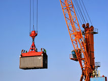 Container crane. Container being lifted by a crane Royalty Free Stock Photos