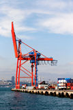 Container crane. Large, red container crane at an industrial harbor Royalty Free Stock Images