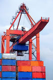 Container crane. Bridge with stacked containers Stock Images