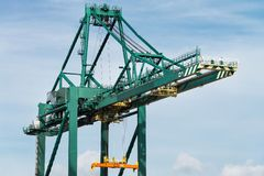 A container crane of a container terminal at a harbor. A huge container crane of a container terminal at a harbor Royalty Free Stock Image