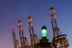 Container Cranes with Beacon Royalty Free Stock Images