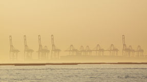 Container cranes on a foggy morning Royalty Free Stock Images