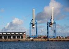 Container Cranes at Harbor Pier with Water Front Stock Photo