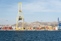Container cranes loading a ship in the port Stock Photos