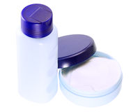 A container of cream bottle. Bottle container with cream and other hygiene products close-up, isolated on a white background stock images