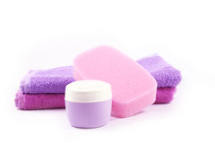 Container of cream, sponge and towels Stock Photo