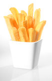 Container of crispy French fries Stock Images
