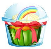 A container with a cupcake inside decorated with a ribbon Stock Image