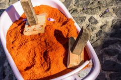 Container of dyed sawdust to make Lent procession carpets, Antigua, Guatemala. Container of dyed sawdust & wooden mallets to make Lent procession carpets in town royalty free stock photography