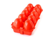 Container for eggs. The red container for eggs on a white background Royalty Free Stock Photo