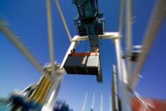 Container en kraan Stock Foto
