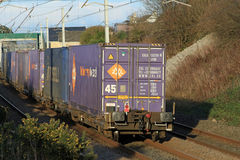 Container at end of freight train on WCML. Royalty Free Stock Image