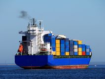 Container Feeder Ship. Container Ship maneuvers in bay Stock Image