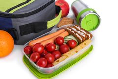 Container with food and a lunch bag. royalty free stock images