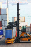 Container Forklift. Forklift-truck stacking the Container Royalty Free Stock Image