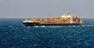 Container freight ship in stormy sea Stock Photos