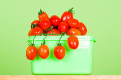 Container with fresh tomatoes Stock Photo
