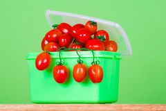 Container with fresh tomatoes Royalty Free Stock Photo