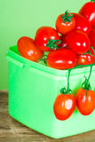 Container with fresh tomatoes Stock Image