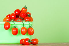 Container with fresh tomatoes Royalty Free Stock Photos