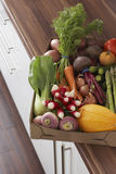 Container full of fresh vegetables on kitchen counter close-up elevated view Royalty Free Stock Photos